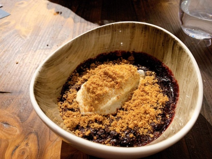 Berries compote with vanilla ice cream